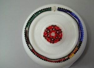 Photograph of necklace representing the genome of phiX174