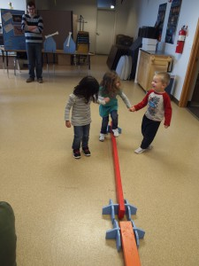 Kids test their balance on both narrow and wide balance beams.
