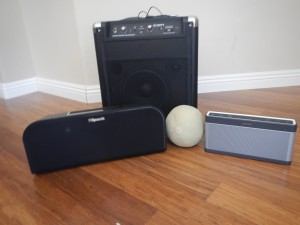 The three speakers I tested, with a cantelope for scale.