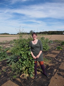 "Amanda Charbonneau next to one of her tallest plants - she's 5'6""!"