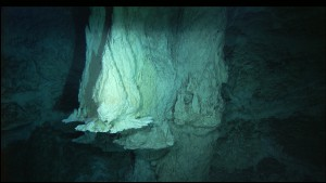 IMAX flange on the northwestern side of the 60-meter-tall Poseidon chimney at the Lost City Hydrothermal Field, venting 55°C, pH 11 fluids. Image courtesy of IFE, URI-JAO, Lost City Science Party, and NOAA.